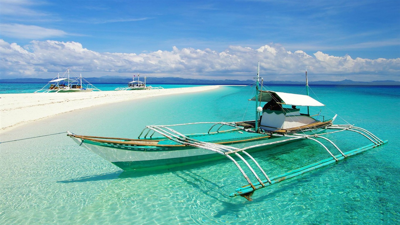 White Sand Beach With Boats