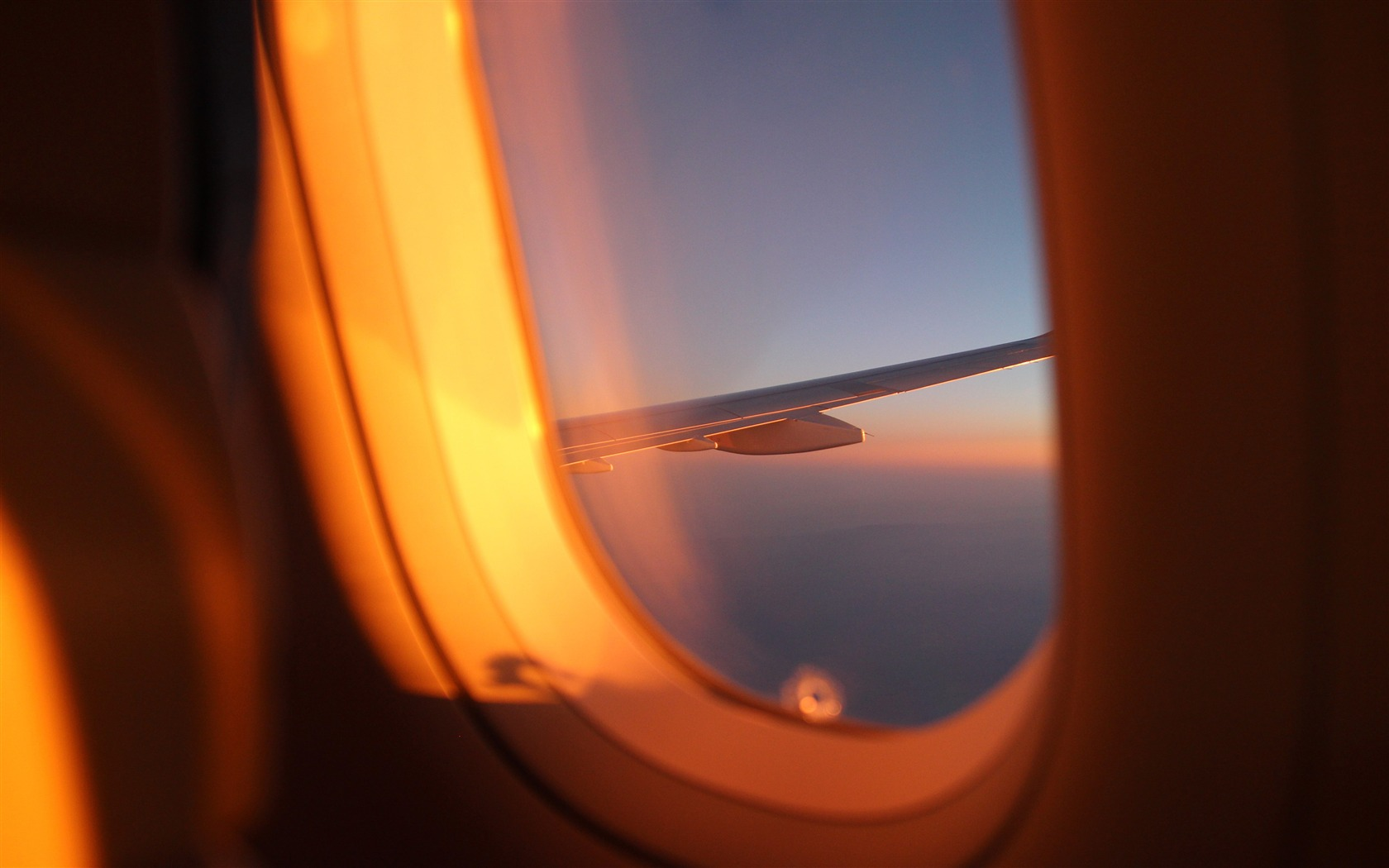 Airplane window outside sunset view 4K HD - 1680x1050 wallpaper download