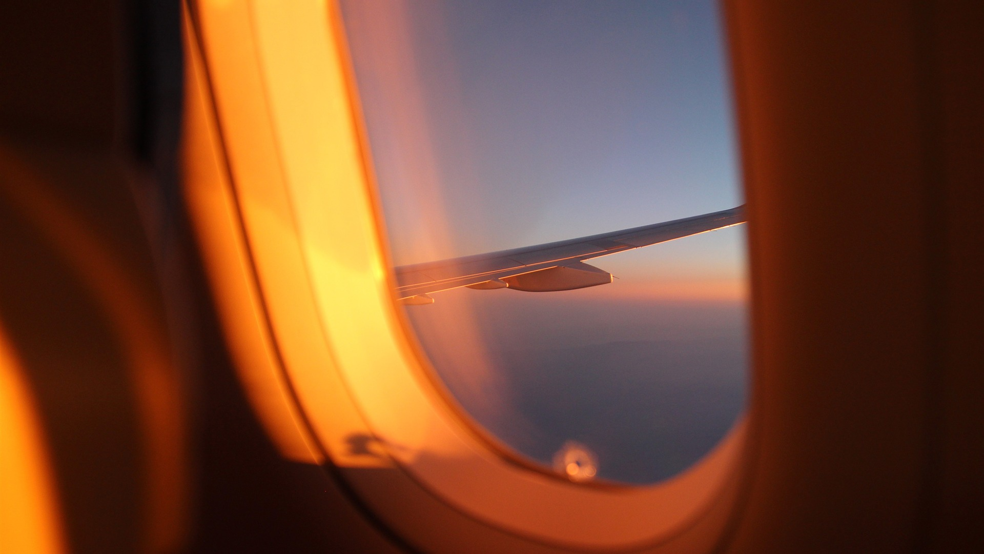Airplane window outside sunset view 4K HD - 1920x1080 wallpaper download