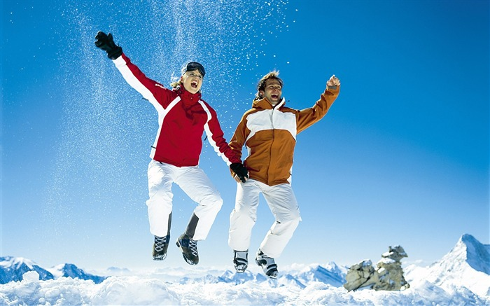 jumping in snow alps winter fun vacation view