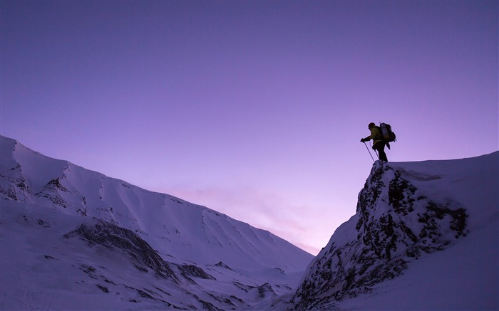 Man standing on snowy mountains-HD Retina Wallpaper Views:1713