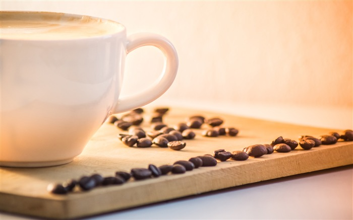 Coffee cup on the desktop Coffee beans Photo HD Wallpaper Views:278