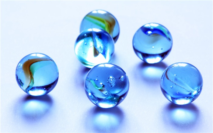 Blue crystal glass marbles closeup Views:297